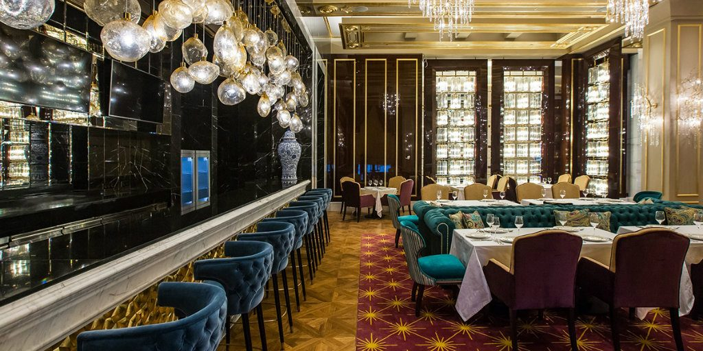 Luxury bar interiors with counter stools
